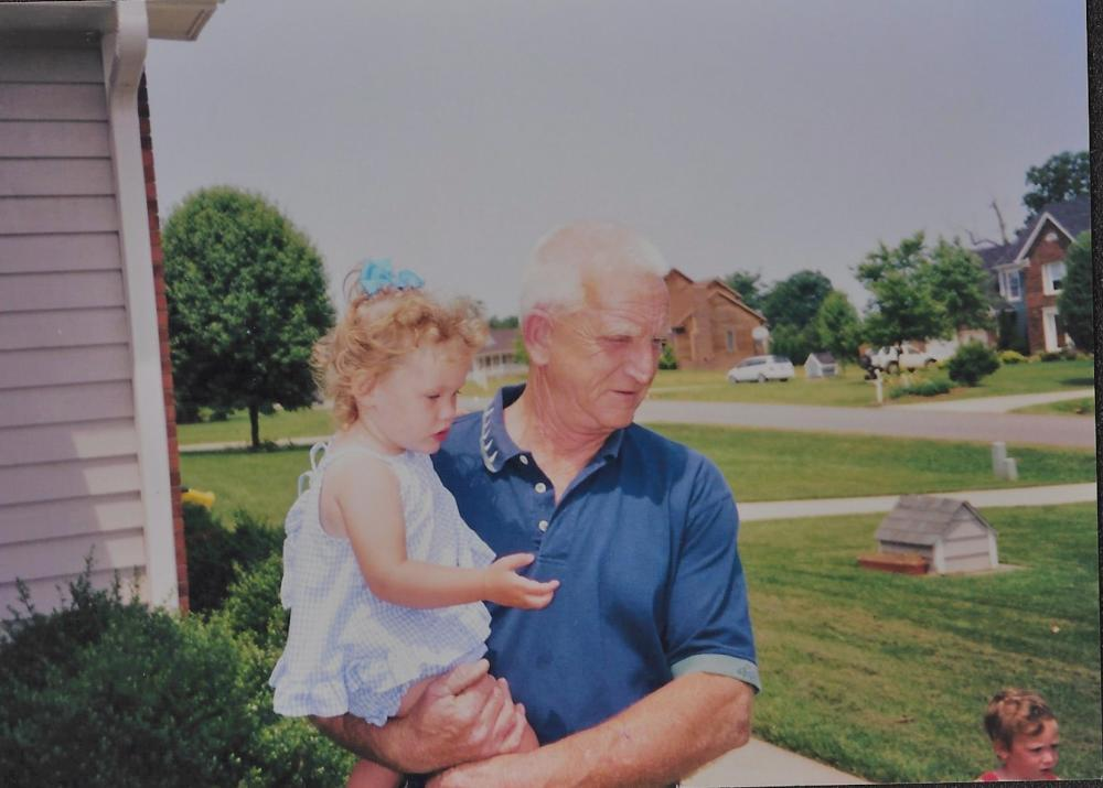 Melvin McCall holding his granddaughter, Reid McCall.
