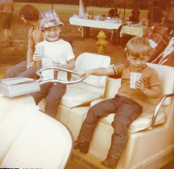 Shawn and Lee McCall, seen here in an old-time golf cart, started golfing at an early age.