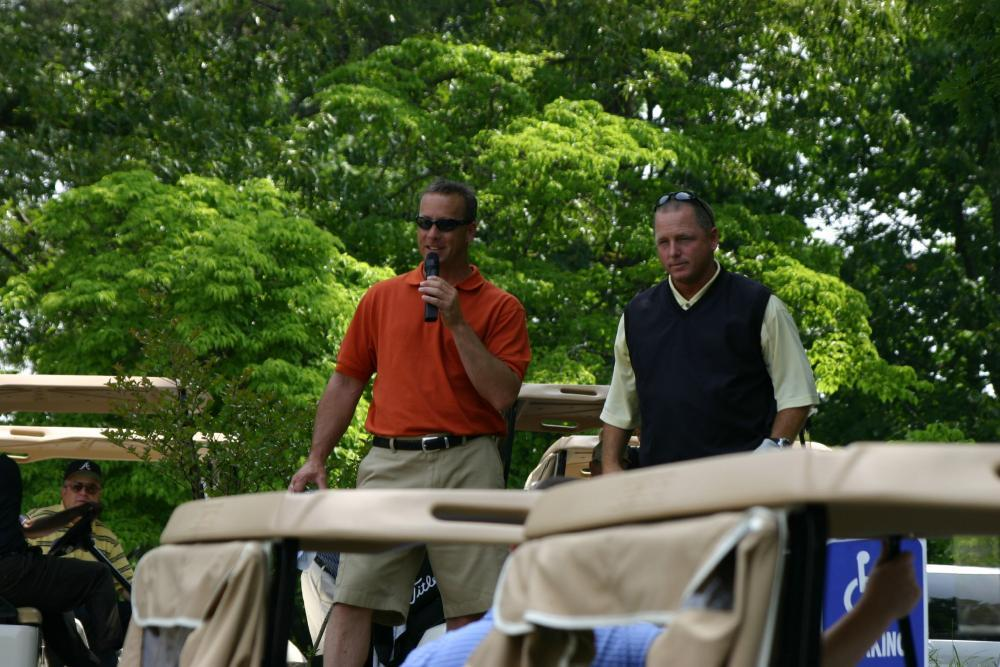 Lee McCall and brother, Shawn, welcome participants to golf tournament.